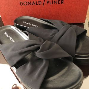 Brand new Donald Pliner black wedge sandal.
